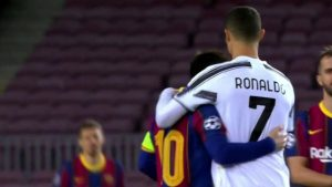 Messi and Ronaldo hug each other